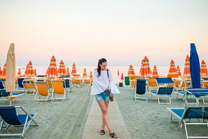 Young woman enjoying summer day on the beach. Beach vacation in Europe