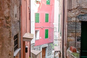 Old beautiful empty narrow streets with outdoor cafe in coastal village in Cinque Terre, Italy