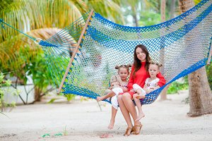 Beautiful mother and daughters on Caribbean beach