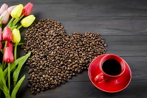 Coffee cup , Coffee beans and tulips