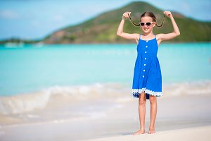 Beautiful Little Girl In Dress At Beach Having Fun Funny Enjoy Summer Vacation