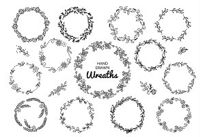 Vintage set of hand drawn rustic wreaths. Floral vector graphic on white board. Nature design elements