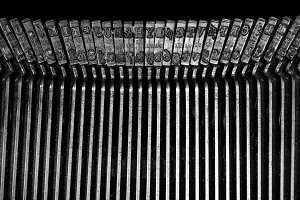 Macro detail of typescript inside electric typewriter