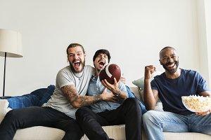 Friends cheering sport league