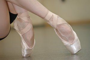 Legs of a ballerina close-up