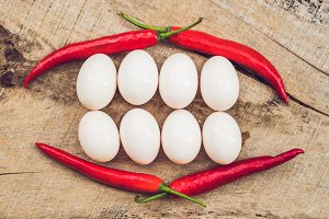 Healthy Smiling food face. Breakfast food concept, happy easter concept. White Smile Teeth from eggs and red pepper