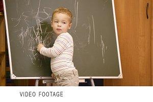 Creative little boy drawing