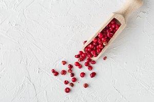 Pink peppercorn in wooden shovel