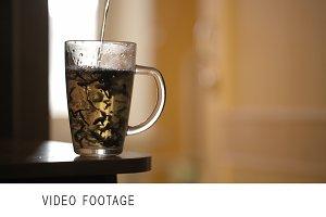 Pouring a mug of herbal tea