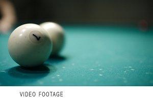 Playing billiards.