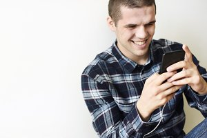Smiling man using a smartphone