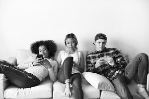 Expressionless smartphone addicts