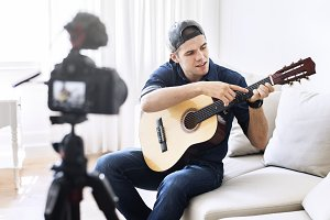 Male vlogger recording music related