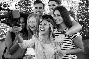 Friends taking a group selfie