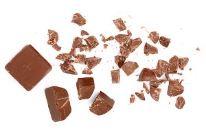 Chocolate pieces isolated on white. Top view. Flat lay
