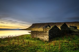 Scenic landscape including ruined house and a lake in Iceland