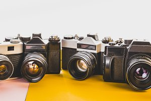 Vintage Film Cameras On Yellow And P