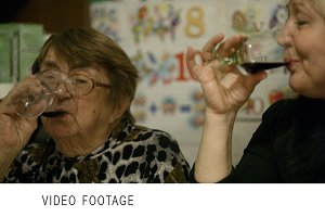 Two women clanging glasses.