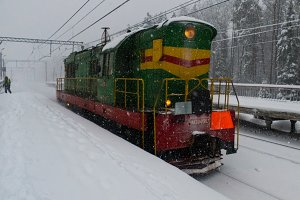 Railway and diesel locomotive with snow