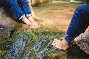 Feet of children in water
