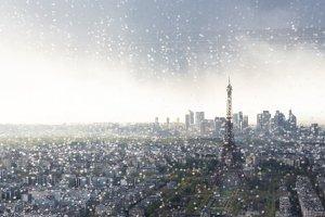 Paris Skyline With Eiffel Tower Seen Through Window With Raindrops