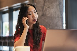 Pretty businesswoman in coffee shop.