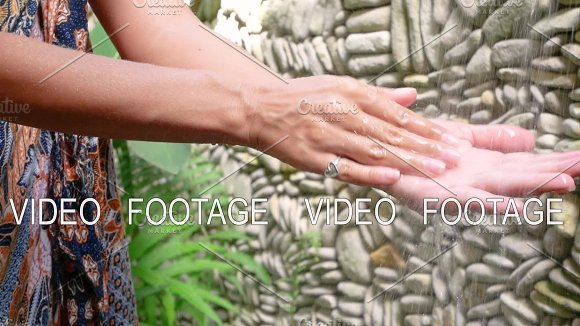 Female Wash Hand Under Water Splash In Fountain In Jungle Bali