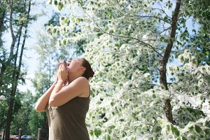 Young Woman Sneezing During Poplar Bloom Season
