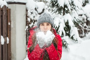 girl in the winter with snow