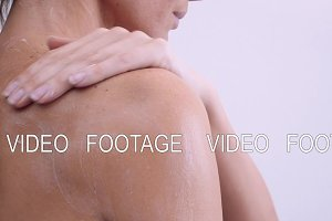 Shoulder and woman back body lotion spreading slow motion close-up