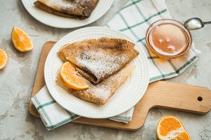 Russian pancakes with honey