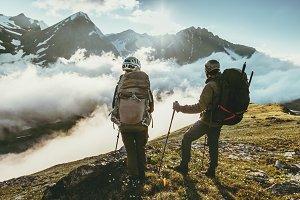 Couple travelers on mountain summit