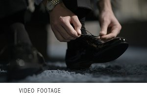 Man tying shoes.