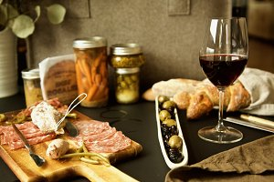 charcuterie and a glass of red wine