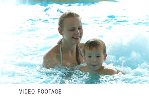 Mother and her son in the swimming