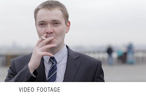 Businessman thinking while smoking