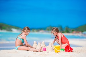 Adorable little girls during summer vacation on the beach