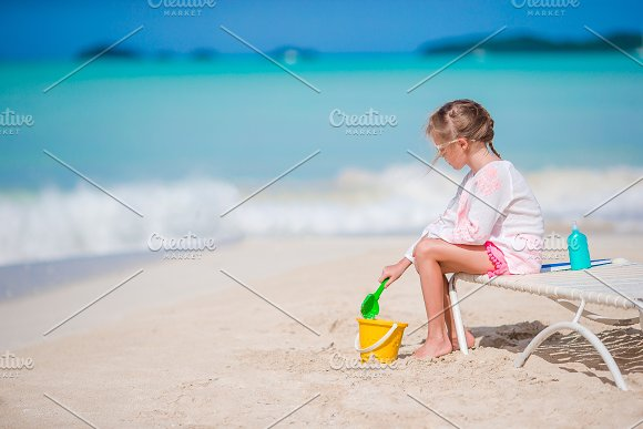 Adorable Little Girl Playing With Toys On Beach Vacation Kid Play With Sand