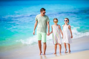 Father and kids enjoying beach summer tropical vacation.