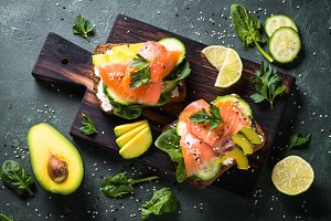 Open sandwich with salmon spinach and avocado.