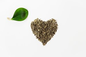 Dry green tea.Heart shape.