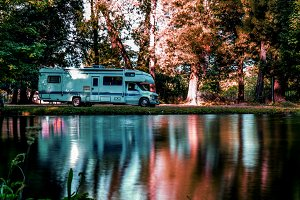 Family trip in motorhome in forest or park in South Chile