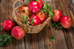 Organic pomegranate fruits with twig