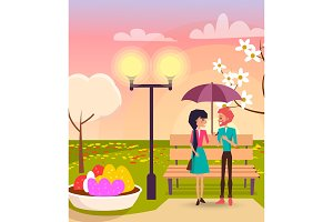 Couple under Umbrella in Park near Streetlight