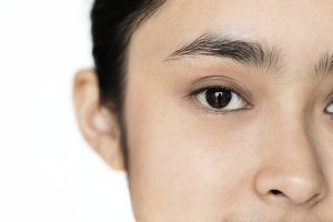 Young Asian girl focused on eyes
