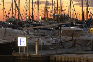 Masts of boats during a sunset