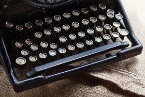 Old black vintage typewriter on Burl
