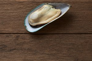 Fresh mussel on the old wood table