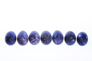 Row of stylish ultra violet marble eggs isolated on white