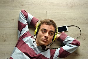 Young man listening music eith mobil